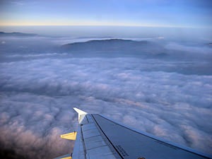 Thumbnail image of A view of clouds from a banking commercial jet.