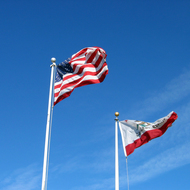 The U.S. and California flags flying in the breeze.