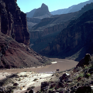 The Colorado River at Hance Rapid in winter (note dusting of snow on the rim near Desert View tower).