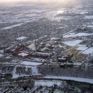 An aerial view of an Eastman Kodak plant in Rochester, NY in winter (February 2007), with a snow-covered Genesee River in the foreground.