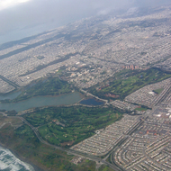 An aerial view of San Francisco, including Lake Merced and the Olympic Country Club.