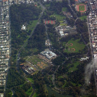 An aerial view of Golden Gate Park, including the De Young Museum (left) and the California Academy of Sciences under construction (above and to the right).