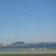 A plane taking off from San Francisco International Airport, with the city in the distance.