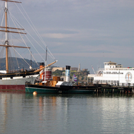 The San Francisco Maritime National Historical Park at the Hyde Street Pier, San Francisco, with Alcatraz in the background.