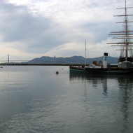 The San Francisco Maritime National Historical Park at the Hyde Street Pier, San Francisco, with the Golden Gate Bridge in the background.