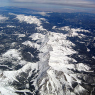 An aerial view of some of Colorado's highest peaks, including Mount Shavano (nearest), Tabeguache Peak, Mount Antero, and Mount Princeton (in the distance).