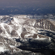 An aerial view of the Rocky Mountains in winter.