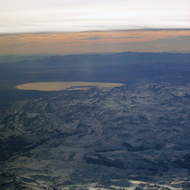 Looking across the crest of the Sierra Nevada Mountains to Mono Lake from a commercial jet.