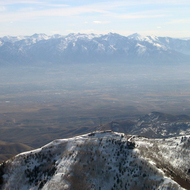 Looking over an installation on Farnsworth Peak of the Oquirrh Range to just south of Salt Lake City and the Wasatch Mountains in the distance.