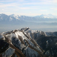 Looking past Nelson Peak of the Oquirrh Range toward the Wasatch Mountains in the distance (Mount Timpanagos on the right, Lone Peak on the left).