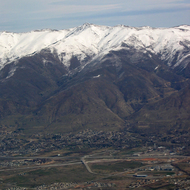 An aerial view of Farmington, Utah, with the Wasatch Mountains and Francis Peak (in the center) with the white domes of the Francis Peak Federal Aviation Administration Radar Station.