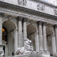 The main branch of the New York Public Library, guarded over by two marble lions named Patience (pictured here) and Fortitude.