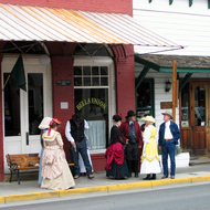 People in the historic town of Jacksonville, Oregon dressed in period costume.
