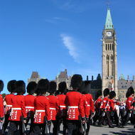 The changing of the guard at the Canadian Parliament, with the Peace Tower of the Centre Block tower in the background.