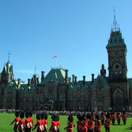 The changing of the guard at the Canadian Parliament, with the East Block in the background.