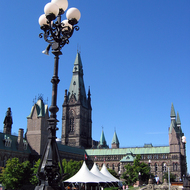 The West Block of the Canadian Parliament with tents erected for visitors during the summer.