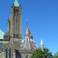 Part of the Centre Block of the Canadian Parliament (left) and the Library of Parliament.