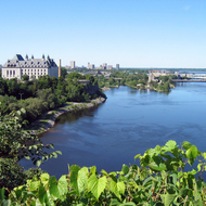 The Supreme Court of Canada (left) and the Pont du Portage Bridge crossing the Ottawa River as seen from Parliament Hill, Ottawa, Ontario.