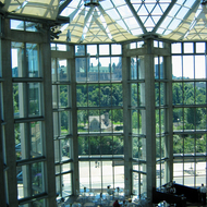 The atrium interior of the National Gallery of Art, Ottawa, Ontario, with the parliament buildings through the windows.