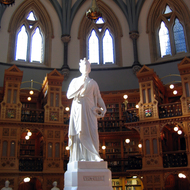 The interior of the Library of Parliament, Ottawa, Canada, including the central statue of Queen Victoria.