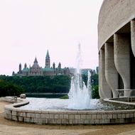 The Canadian Museum of Civilization (foreground, in Hull, Quebec) with the Canadian Parliament in the background, across the Ottawa River in Ottawa.