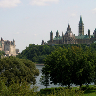 The Fairmont Chateau Laurier (left) and the Canadian Parliament across the Ottawa River from the grounds of the Canadian Museum of Civilization in Hull, Quebec.