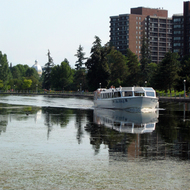 A tour boat on the Rideau Canal in Ottawa, Ontario.