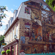 A mural on the side of a building in the lower town of old town Quebec.