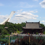 A pagoda at the Montreal Botanical Gardens with the Olympic Tower beyond.