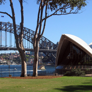 A view of the Sydney Harbour Bridge and the Sydney Opera House from the Government House lawn.
