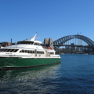 A ferry and the Sydney Harbour Bridge.