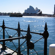 A ferry and the Sydney Opera House from the other side of Sydney Cove.