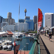 The Pyrmont Bridge across Darling Harbour, looking toward downtown Sydney and the Sydney Tower.