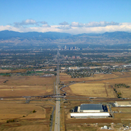 An aerial view of Denver and the Rocky Mountains beyond from the East.