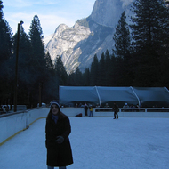 The ice skating rink at Curry Village on the Yosemite valley floor, with Half Dome in the background.