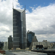 Some buildings in downtown Melbourne, including the top of the landmark conical building that marks the Melbourne Central shopping center.