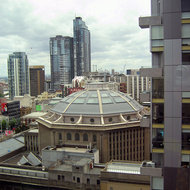 A view of the State Library of Victoria and surrounding buildings in downtown Melbourne.