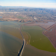 An aerial view of Dunbarton Bridge across San Francisco Bay, looking toward Newark, Union City, and Fremont.