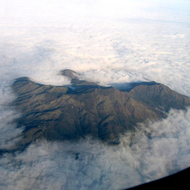 An aerial view of Mount Diablo poking out through the cloud cover.