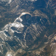 An aerial view of Yosemite Valley, including Half Dome and Nevada Falls.