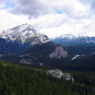 A view of Mount Norquay, the Banff Springs Hotel (mid-distance), and the town of Banff from Sulphur Mountain Gondola in Banff National Park.