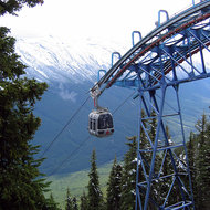 The Sulphur Mountain Gondola in July, with a fresh dusting of snow.