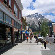 Downtown Banff in July, looking at Mount Norquay.
