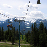 The chair lift at Lake Louise Mountain Resort, looking to Lake Louise across the valley.