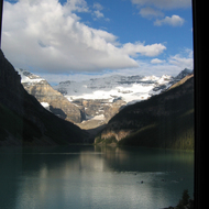 A view of Lake Louise from a room in the Chateau Lake Louise, with rowers on the lake.