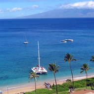 Boats along the Kaanapali Beach on Maui, from the Westin Maui Hotel, with Molokai in the background.
