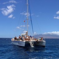 A catamaran anchored for snorkeling on the Maui coast.