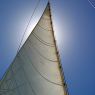 A catamaran sail in the sun.