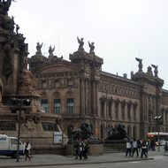 The base of the Monument a Colon (Columbus) with the Aduana de Barcelona (old customs) building.