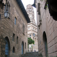 A view along a street to the church tower in the Poble Espanyol.